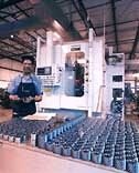 History of Gear Motions - employee in gear manufacturing facility