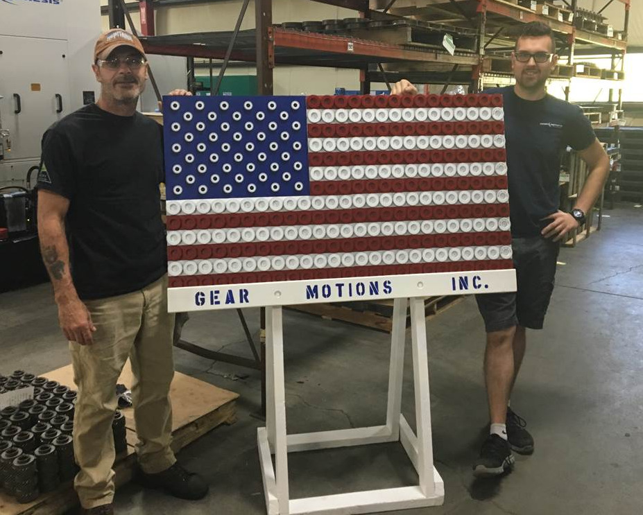 Ron Rafferty and RJ Rafferty of Gear Motions stand with the custom made American flag made out of gears at Nixon Gear, Syracuse, NY