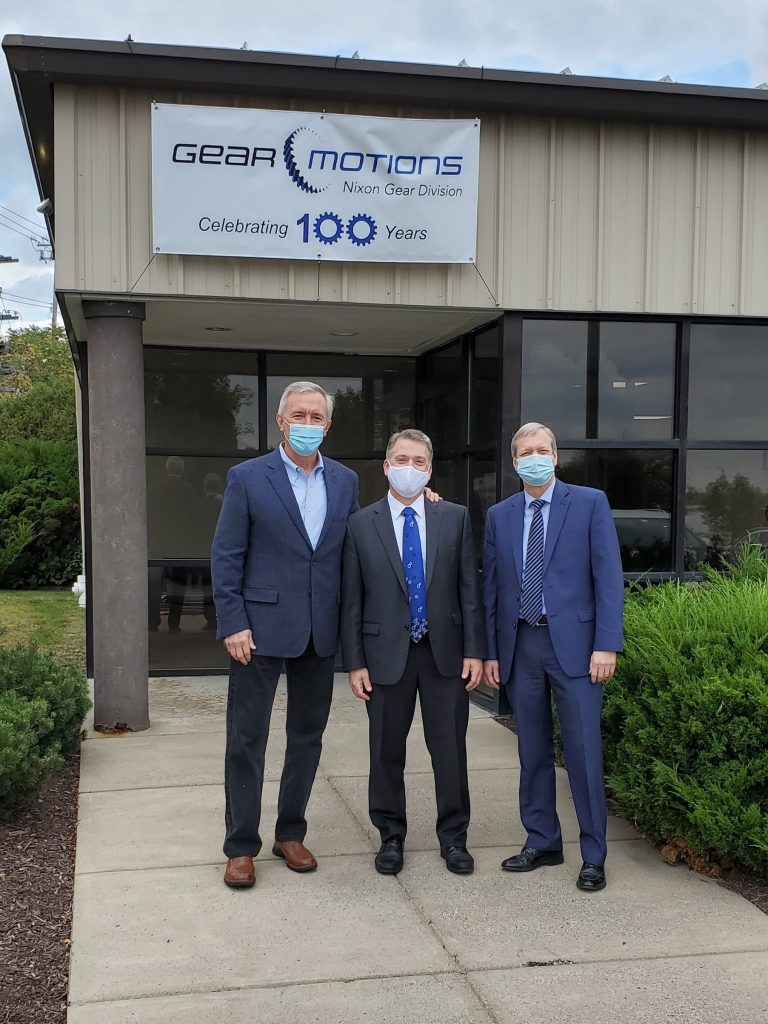 U.S. Congressman John Katko, Dean Burrows, and Randy Wolken standing in front of Gear Motions Nixon Gear Division