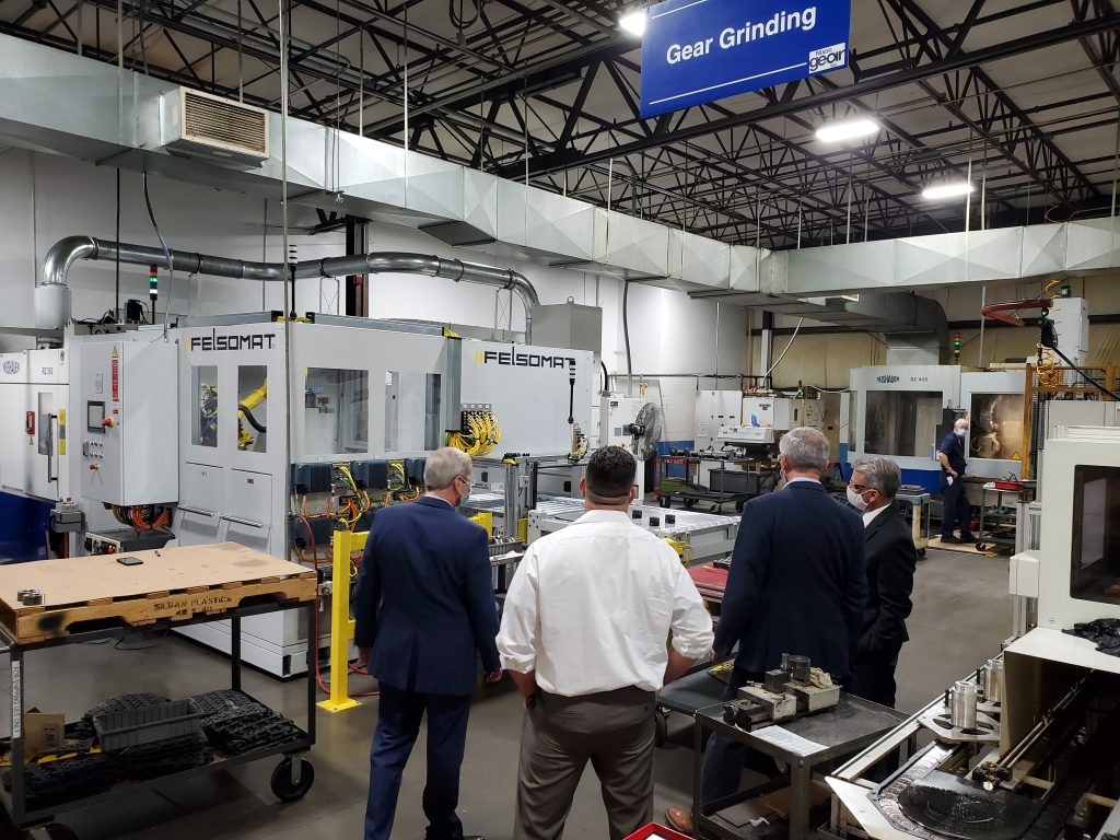 John Katko and Randy Wolken admire the new gear grinding machine and automation recently installed at Nixon Gear