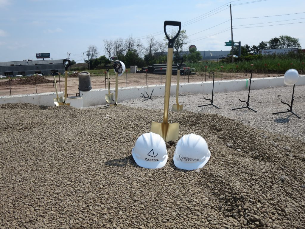 Shovels and hard hats in the dirt at Gear Motions Buffalo Ops Groundbreaking Ceremony